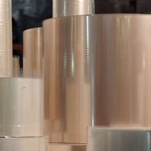 stacked rolls of translucent packaging film