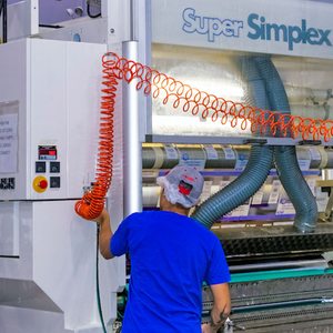employee operating super simplex machine